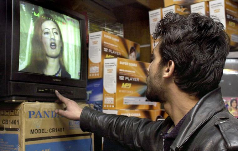 An Afghan man, Noor Ahmad, watchesa musicvideo thatfeatures the pop idol Salma in Kabul onTuesday.