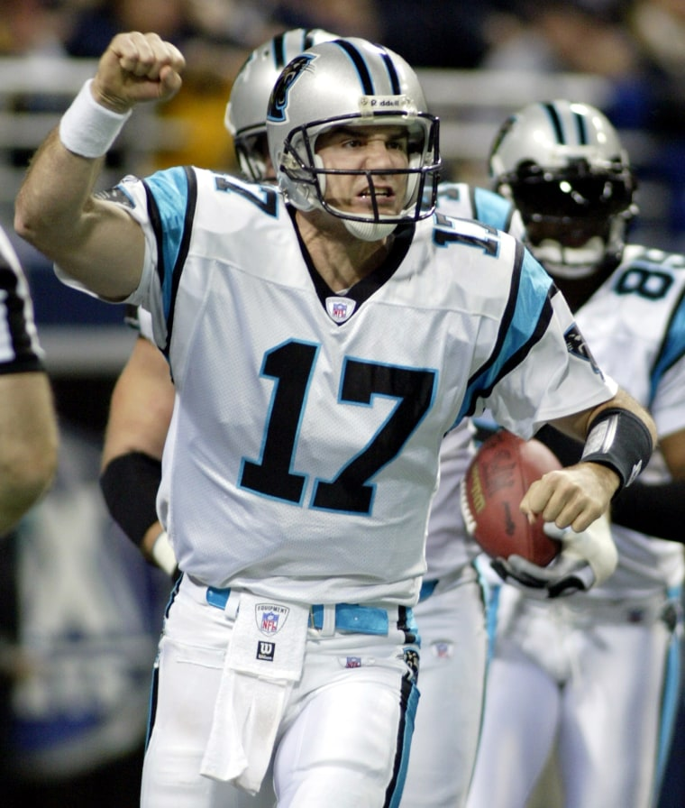 PANTHERS JAKE DELHOMME CELEBRATES A TOUCHDOWN AGAINST RAMS