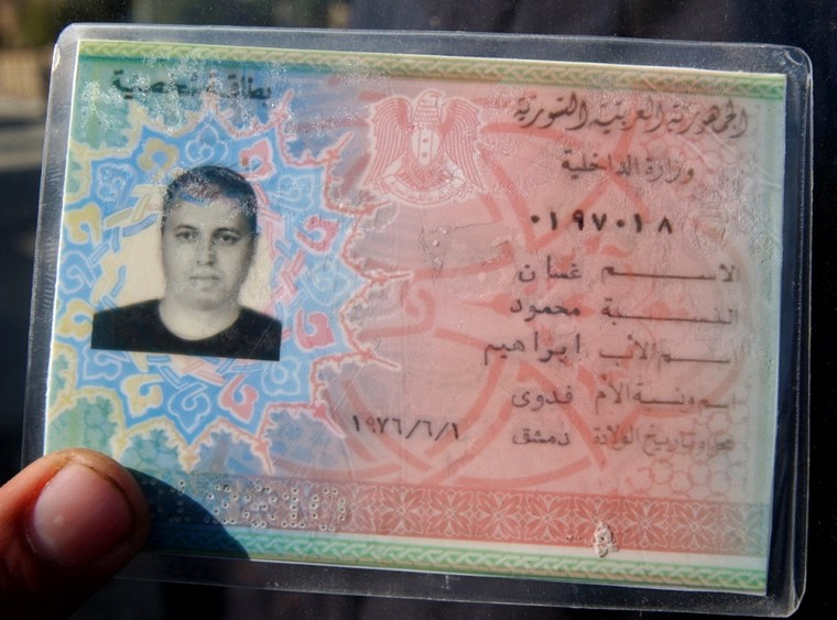 An ID card of Ghassan Mahmoud Ibrahim, a Syrian who was killed Monday along with two Yemenis at Al-Moalemeen district near Baghdad.