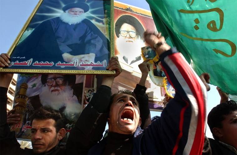 Ata demonstration in Baghdad Tuesday,Shiite Muslims carrying flags and posters of clerical leader Mohammed Sadiq al-Sadr call forSaddam Hussein's execution.