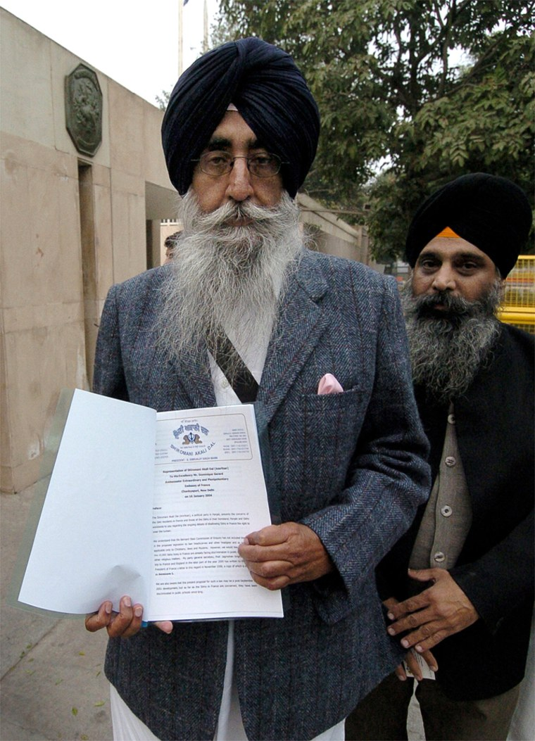 Leading Sikh activist and Indian member of parliament,S. Simranjit Singh Mann, displays a memorandum seeking a reversal of the proposed ban on religious symbols, in front of the French Embassy in New Delhi on Jan. 16.