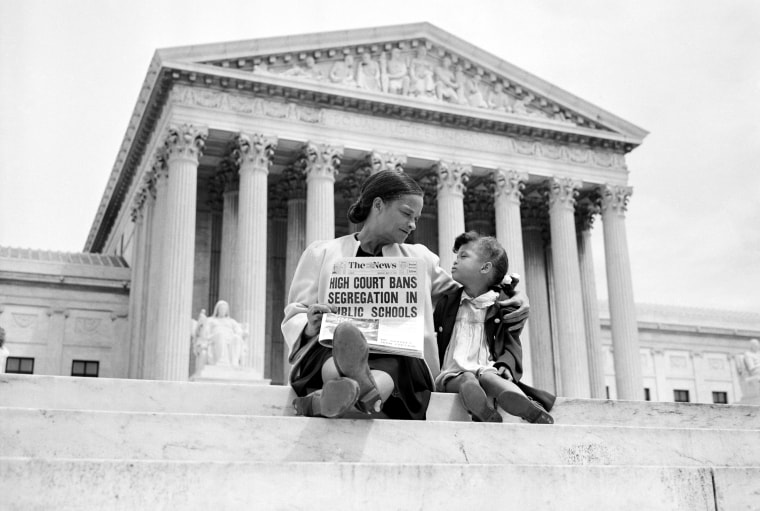 May 1954: Nettie Hunt and her daughter Nickie sit on the steps of the U.S. Supreme Court, after the high court's ruling in the Brown vs. Board of Education case that segregation in public schools was unconstitutional.