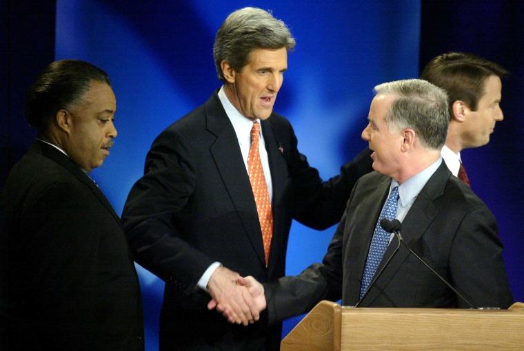 Al Sharpton, left,and John Kerry, center,greet Howard Dean before the debate.