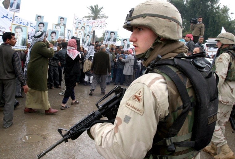 U.S. ARMY TROOPS WATCH PROTEST BY IRAQI GROUP AGAINST PLANNED FEDERAL SYSTEM