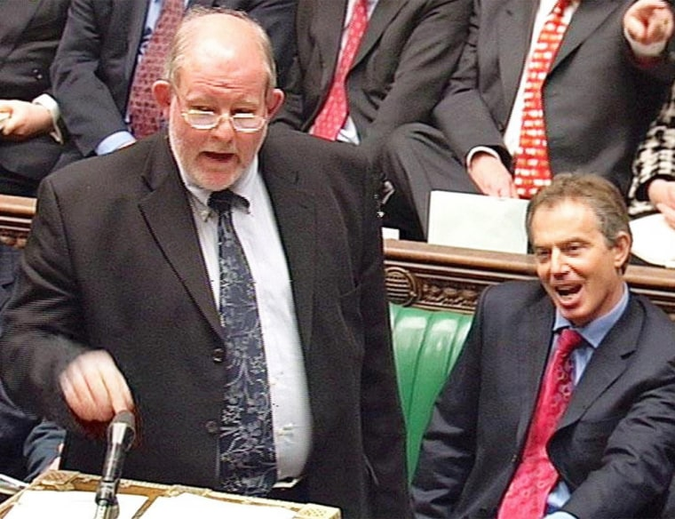 British Education Secretary Charles Clarke, left, opens the debate in the House of Commons with Prime Minister Tony Blair sitting at his side in London on Tuesday.