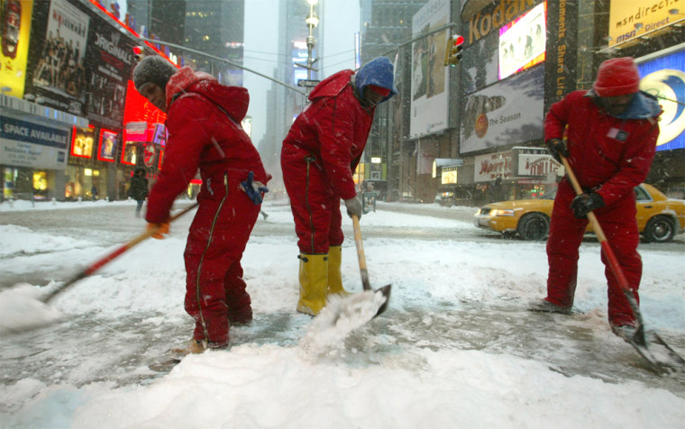 Workers shovel snow Wednesday in New York.