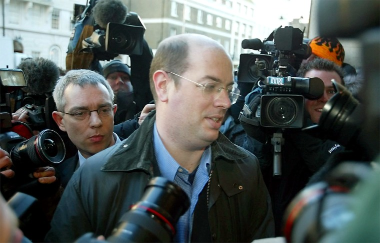 BBC TV reporter Andrew Gilligan arrives at the BBC headquarters in London on Wednesday.