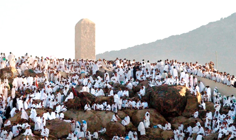 Muslim pilgrims pray arround the holy stone, center, on Mount Arafat, northeast of the city of Mecca, during the annual Muslimhajj on Saturday.