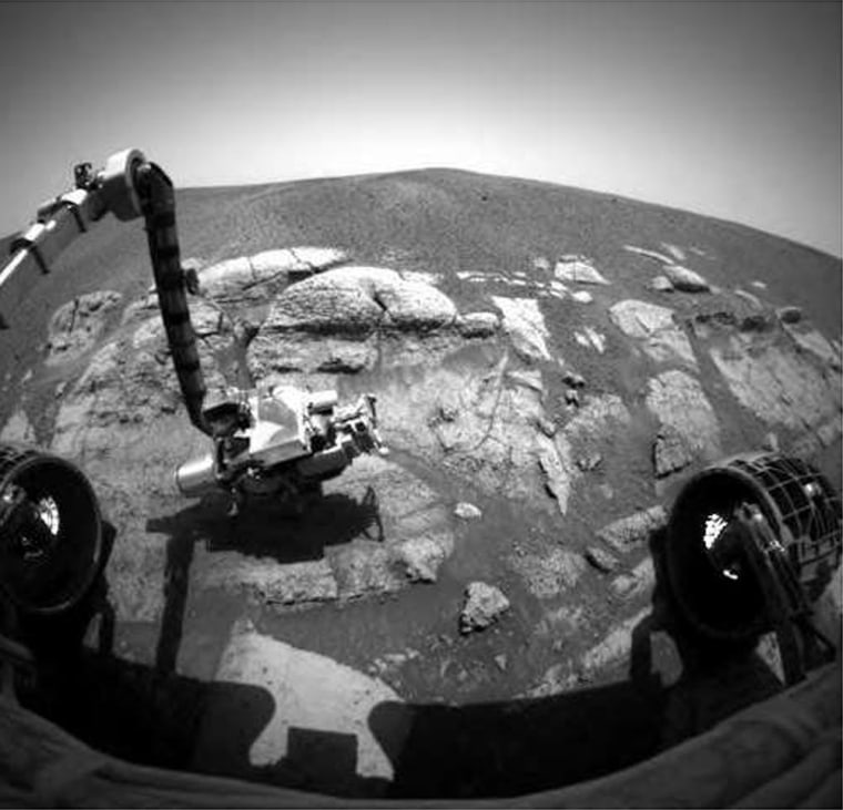 The latest picture from the Opportunity rover's front hazard avoidance camera shows the probe's robotic arm setting scientific instruments down on a rock named El Capitan.