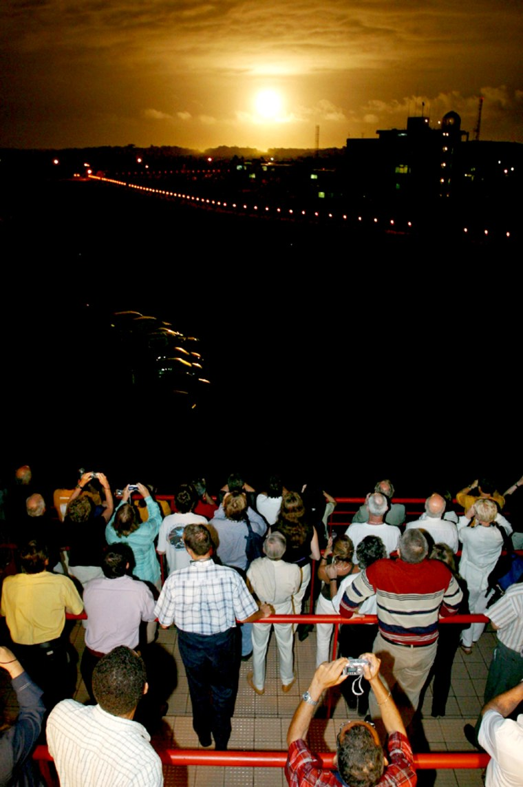 A crowd watches Tuesday's launch of the Ariane 5 rocket from the Kourou space center, bearing the European Space Agency's Rosetta comet probe into space.