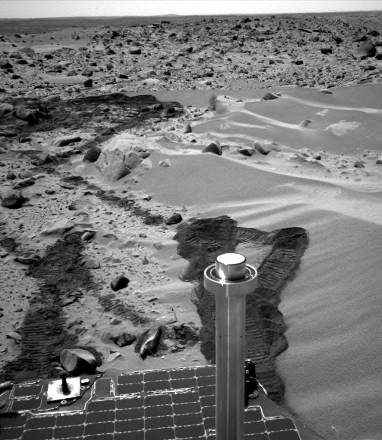 """The Spirit rover's navigation camera looks back atthe vehicle'strail alongside a drift of material known as """"Serpent."""" Spirit spun its wheels in the drift to expose the fine-grained dust beneath the surface."""