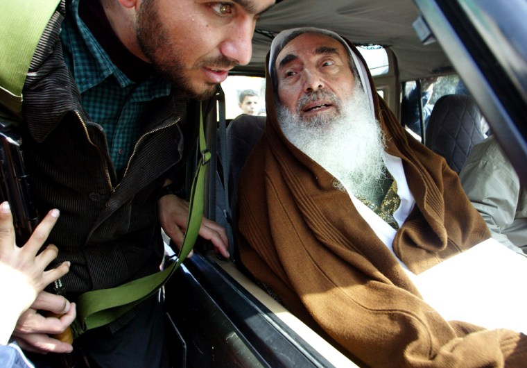 Palestinian Hamas spiritual leader Sheik Ahmed Yassin, pictured talkingto a bodyguardduring a protest against Israel's separation barrier on Feb. 23, was killed in an Israeli missile strike on Monday.