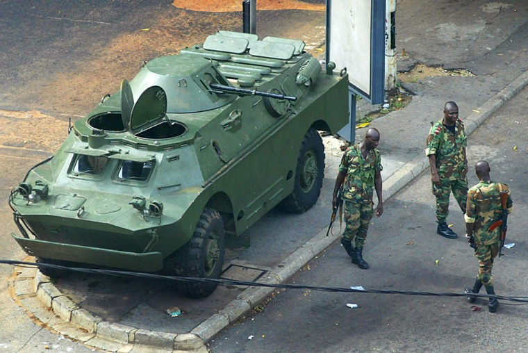 An armored personnel carrier with troops on guard in Abidjan, Ivory Coast, on Thursday.