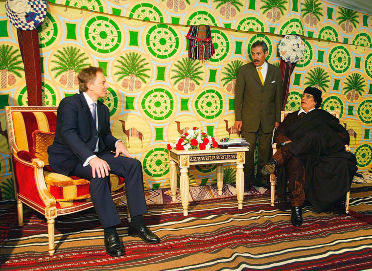 Britain's Prime Minister Tony Blair, left, holds talks with Libyan leader Col. Moammar Gadhafi at a ceremonial tent outside Tripoli on Thursday.