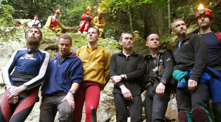 BRITISH CAVERS POSE OUTSIDE CAVE AFTER BEING RESCUED