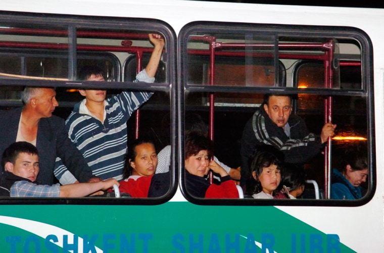 Local residents areevacuated from the area around the scene of a hostage taking in Tashkent, Uzbekistan, on Wednesday.