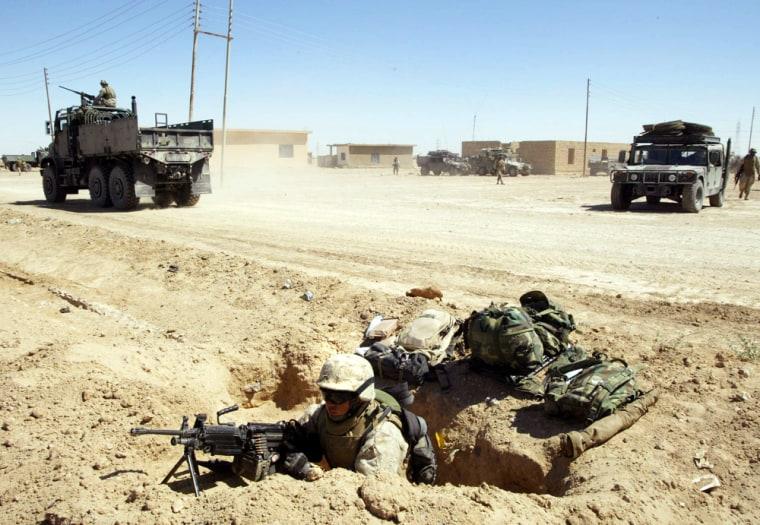 Marine Pfc. Draper Donavanuwas dug in Monday on the outskirts of Fallujah.