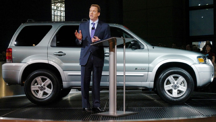 BILL FORD SPEAKS IN FRONT OF A 2005 ESCAPE HYBRID AT NEW YORK AUTOMOBILE SHOW