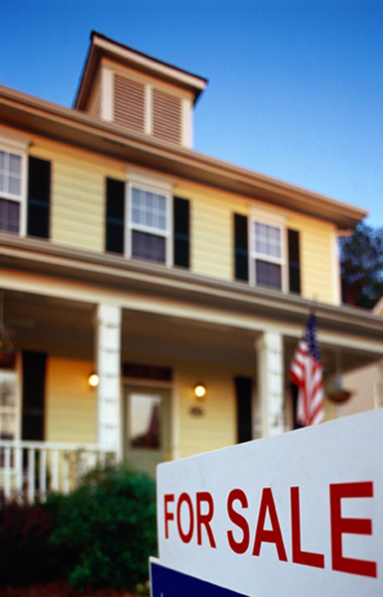 Home For Sale color image, vertical, outdoors, center, lifestyles, for sale sign, house, building exterior, text, one item, american flag, day, photography, selective focus, low angle view, nobody  AA041321HOUSING, HOUSE FOR SALE, HOUSING, HOME SALES, REAL ESTATE, MORTGAGE