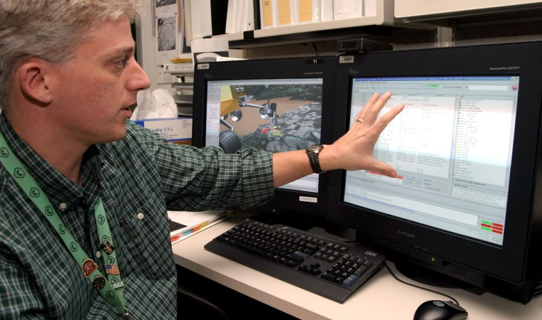 Rover planner Eric Baumgartner shows how a software program convertsa long list of textcommands into an animated simulation of a rover drive on Mars.