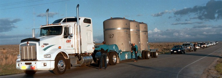 Preparations are made to truck plutonium-contaminated waste out of the Idaho National Engineering and Environmental Laboratory in this 1999photo. The lab is among the sites that could see cleanup money withheld.