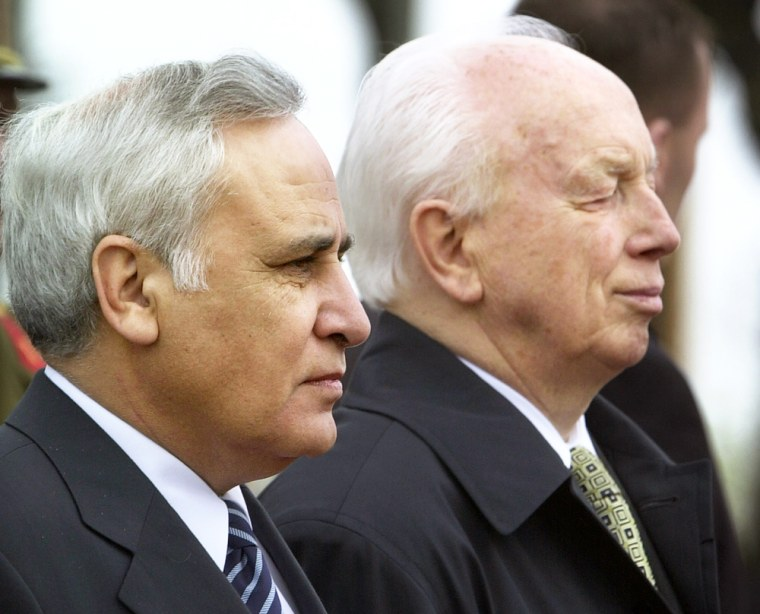 President of Israel, Moshe Katsav, left, and his Hungarian counterpart, Ferenc Madl, right, listen to their national anthems before the start of their meeting in the Hungarian Presidential Building in Budapest on Tuesday.