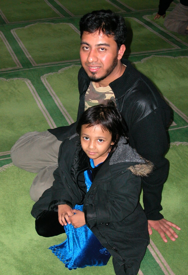 Hasan Faruq and his daughter, Zainab,are seen following afternoon prayers at the East London Mosque, in the British capital.