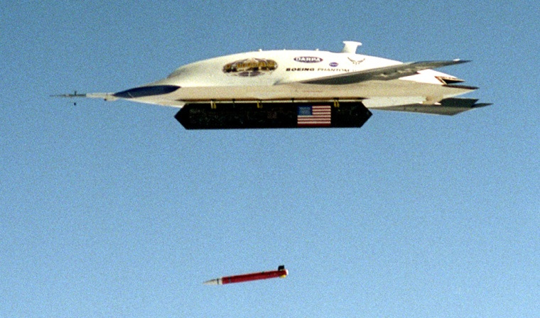 A Boeing Joint Unmanned Combat Air System X-45 aircraft releases an inert GPS-guided bomb Sundayat the Naval Air Warfare Center Weapons Division range in China Lake, Calif.