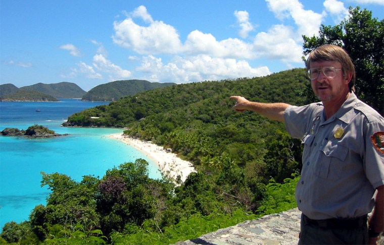 Rafe Boulon, the chief of resources management for Virgin Islands National Park on the island of St. John, points to Trunk Bay, a popular beach his family once owned and where he was born.