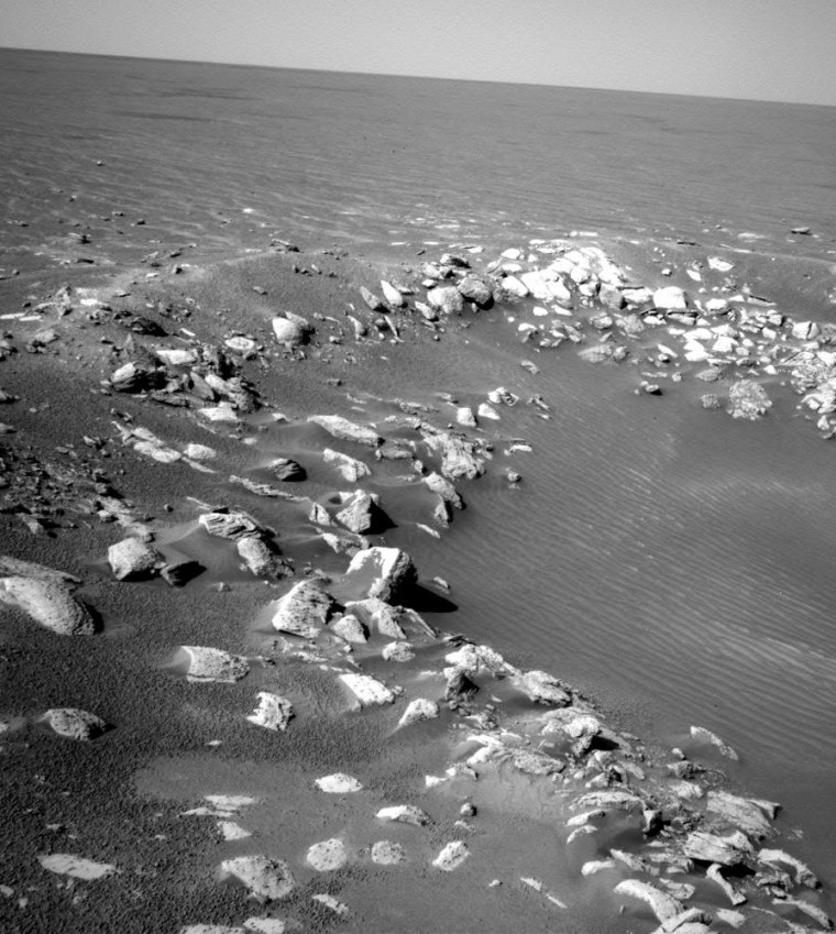 Jumbled blocks of rock outline the rim of Fram Crater, an intermediate stop along the Opportunity rover's route to the much larger Endurance Crater.