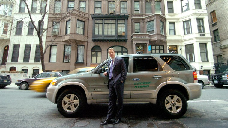 """Ford Motor Company Chairman and CEO Bill Ford with the new Ford Escape Hybrid after the """"Manhattan on a Tank of Gas"""" fuel economy drive earlier this month."""