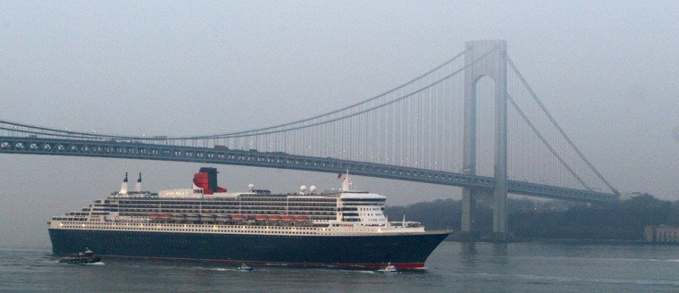 The Queen Mary 2 sails under the Verrazano Narrows bridge at low tide, six days after leaving England.