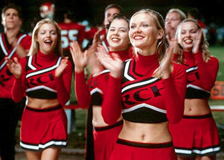 """Actress Kirsten Dunst, foreground, is seen leadingher cheerleading squad during the NBC Universal film""""Bring It On."""" The movie'schoreographer isa consultant on THQ's new cheerleading video game."""