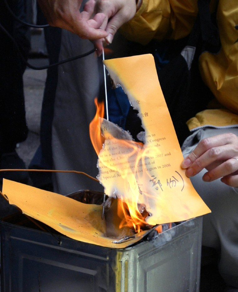 PROTESTERS BURN REPORT OUTSIDE HONG KONG GOVERNMENT HEADQUARTERS