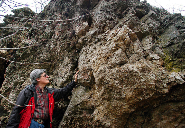 Geologist Bill Cordua stands near some angular upheavals in rock formationsnear Waverly, Wis. Cordua says the formations give clues that something cataclysmic occurred in the area. Geologists have now determined that a meteorite struck the site 450 million years ago.