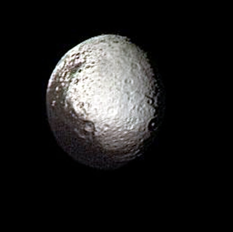 This image of Iapetus, captured by NASA's Voyager 2 spacecraft in 1981, shows the stark black-and-white appearance of its surface.