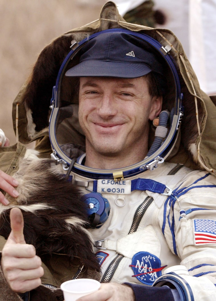 NASAastronaut Michael Foale gives a thumbs-up sign shortly after Friday's landing in a Russian Soyuz spacecraft near the town of Arkalyk in north-central Kazakhstan.
