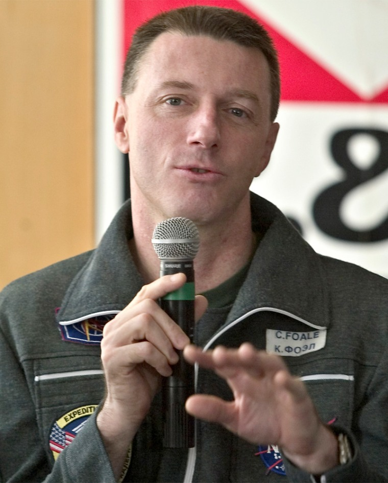 U.S. astronaut Michael Foale, just back from six months aboard the international space station, speaks to reporters Wednesday.