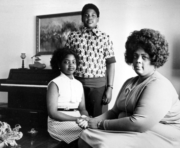 Linda Brown Smith, right, and her two children pose in their home in 1974 in Topeka, Kan. Smith was a 3rd grader when her father started the class-action suit in 1951 of the Brown v. Board of Education of Topeka, Kan.