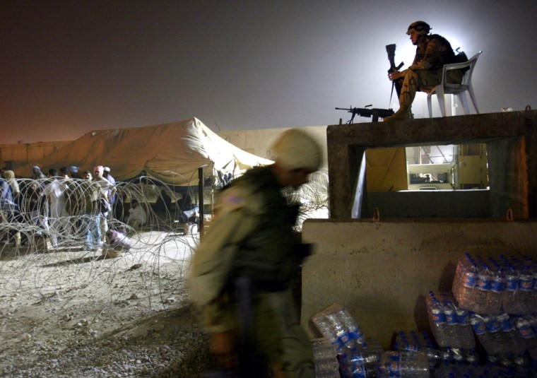 Military policemen guard a detainee processing center at the Abu Ghraib Prison on the outskirts of Baghdad.