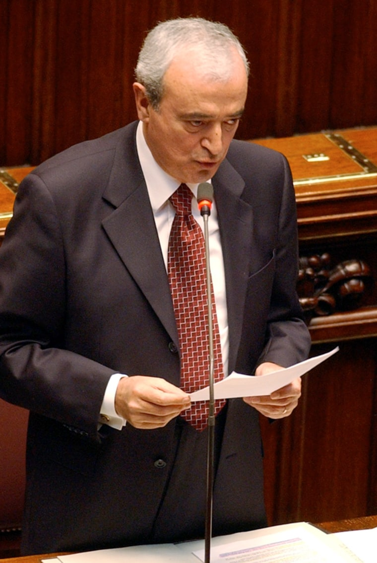Italian Defense Minister Antonio Martino speaks during a session on Iraq at the Italian Parliament on Wednesday. Martino said the government was surprised and dismayed at the abuses of Iraqi prisoners.