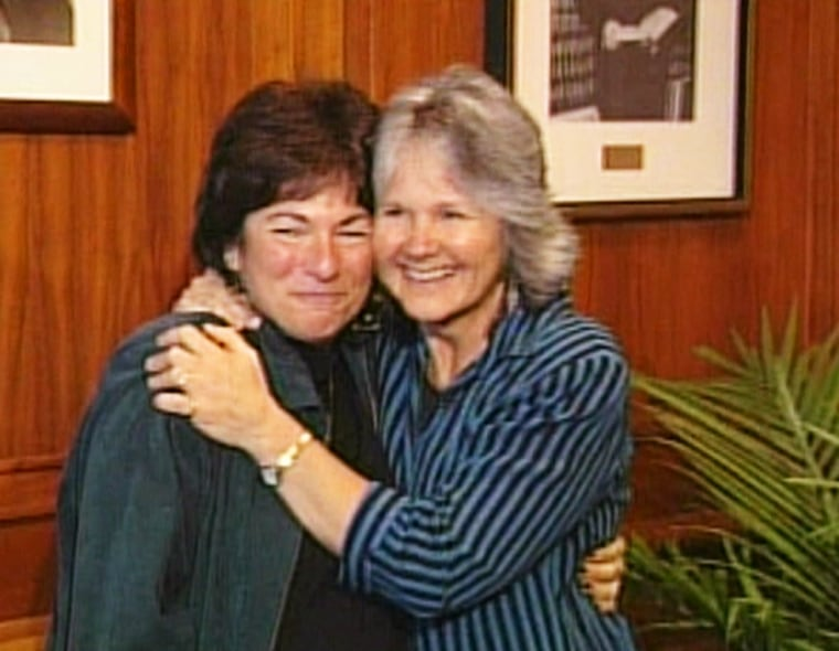 Tanya McCloskey, right, and Marcia Kadish embrace after their marriage ceremony in Cambridge, Mass., onMonday, which was among the first in the state.