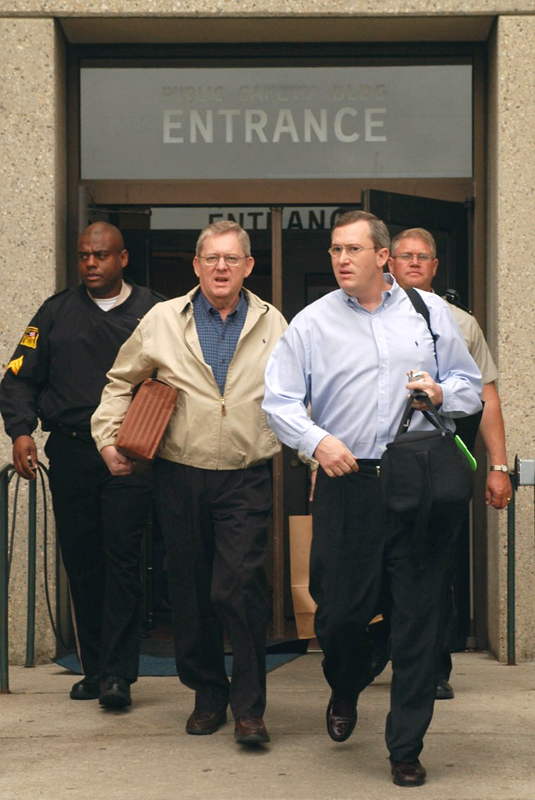 Former U.S. Rep. Bill Janklow, center left, walks with his son Russ Janklow as he leaves the Minnehaha County Jail on Monday.