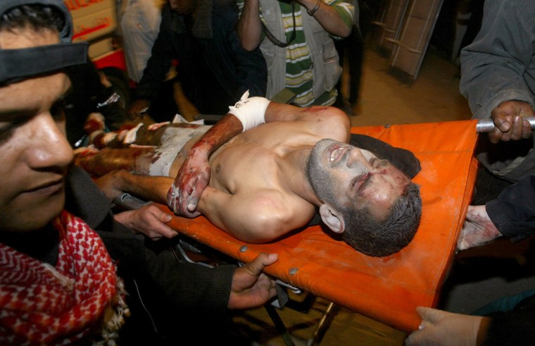 A Palestinian wounded Tuesday in an Israeli missile strike is rushed into Najar hospital in the Rafah refugee camp, southern Gaza Strip.