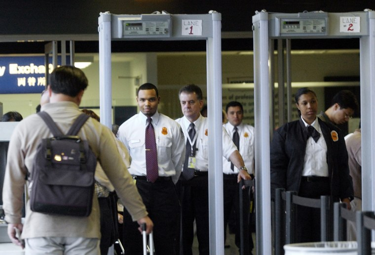 Transportation Security Administration screeners await a passenger at Los Angeles International Airport.