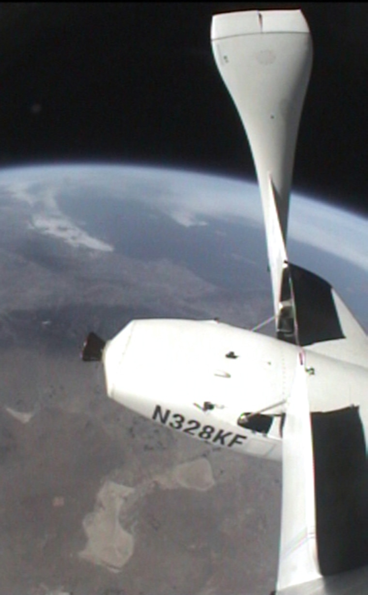 SpaceShipOne is shown in its feathered-wing configurationat an altitude of more than200,000 feet above California's Mojave Desert.San Diego is at left, Santa Barbara is under the left wing and Edwards Air Force Base is at right center.