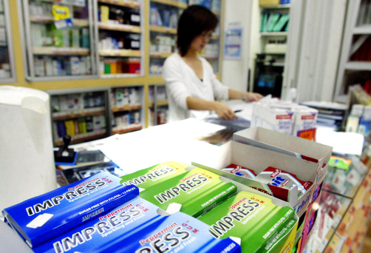 PHARMACIST WITH CHEWING GUM DISPLAY