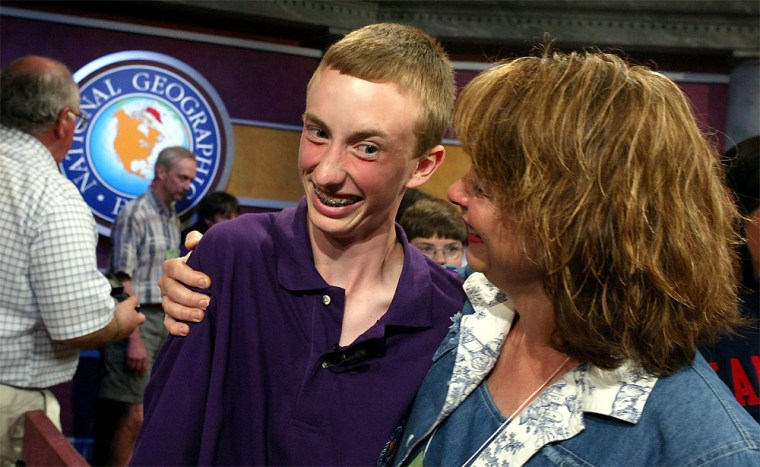 Eighth grader Andrew Wojtanik of Overland Park, Kan., gets a hug from his mother Dianna after his win Wednesday.