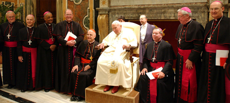 Americanbishops pose for a group picture during their meeting with Pope John Paul II at the Clementine hallin the Vatican on Friday.