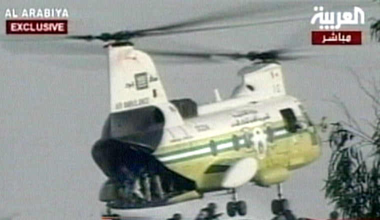 Al-Arabiya TV showed a helicopter unloading Saudi security forces onto the roof of the building where militants were holding hostages Sunday.